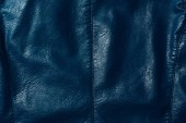 elevated view of dark blue leather shiny textile as background