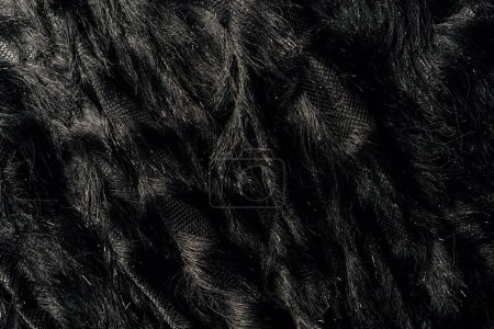 Photo for Elevated view of furry black textile as background - Royalty Free Image