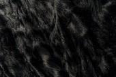 vue de fourrure textile noir comme toile de fond
