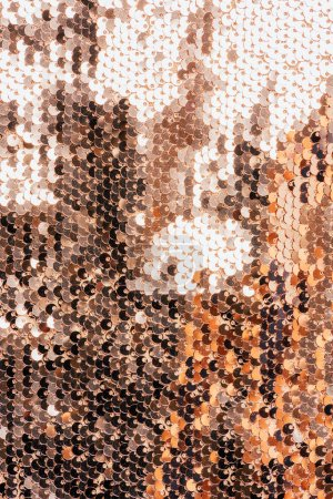 Photo for Top view of beige textile with shiny sequins as background - Royalty Free Image