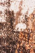 vue de dessus du textile beige avec des paillettes brillantes comme toile de fond