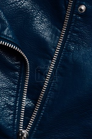 top view of dark blue leather textile with zipper as background