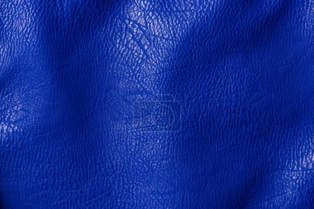 top view of leather blue shiny textile as background