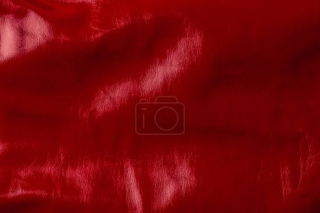 top view of red shiny textile as background