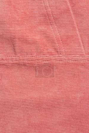 elevated view of pink corduroy textile as background