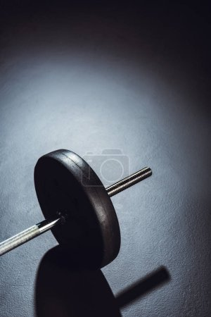 Photo for Partial view of barbell on floor with shadow at gym - Royalty Free Image