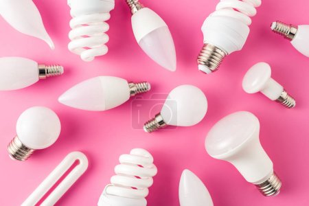 top view of various light bulbs on pink background