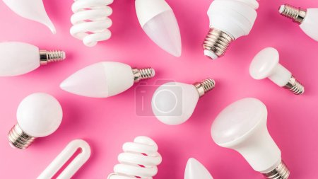 top view of pattern from various light bulbs on pink