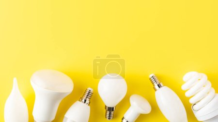 Photo for Close-up view of various types of lamps on yellow background - Royalty Free Image