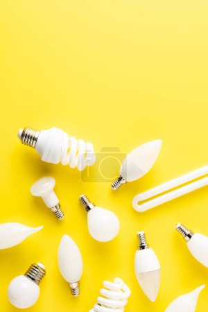 top view of various types of lamps on yellow background