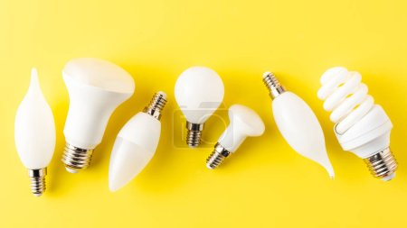 Photo for Top view of various types of light bulbs on yellow - Royalty Free Image