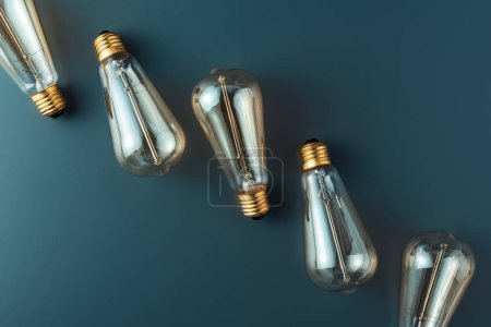 close-up view of light bulbs on grey background, energy concept