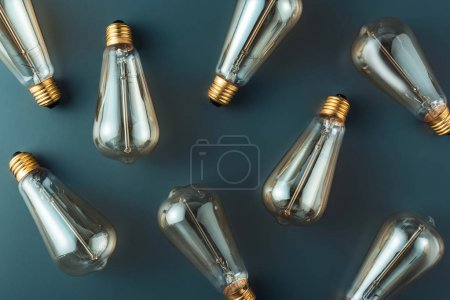 top view of light bulbs on grey background, energy concept