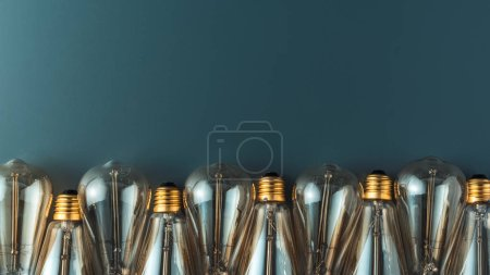 close-up view of light bulbs in row on grey background