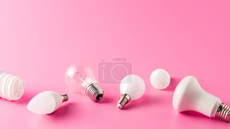 close-up view of various light bulbs on pink, energy concept