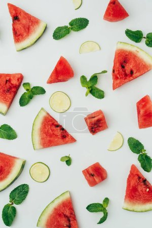 Photo for Background with fresh red watermelon and lime slices with mint leaves on grey, top view - Royalty Free Image