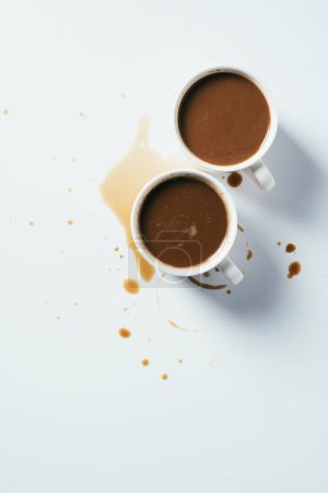 Photo for Top view of cups of coffee standing messy on white surface - Royalty Free Image