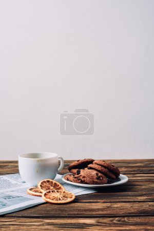 Photo for Cup of coffee with cookies and spices on rustic wooden table - Royalty Free Image