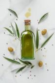 "Постер, картина, фотообои ""Еда укладка бутылки оливковое масло и оливки на мраморном столе"""