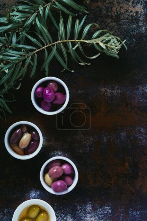 Photo for Top view of olives for oil preparation in bowls on shabby surface - Royalty Free Image