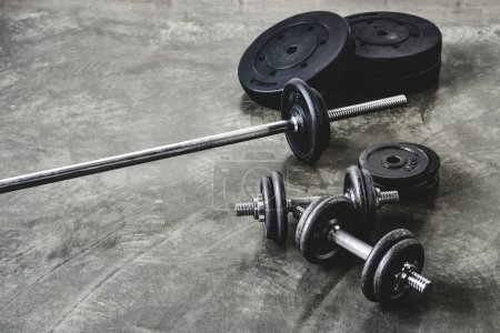 high angle view of various gym equipment on concrete floor