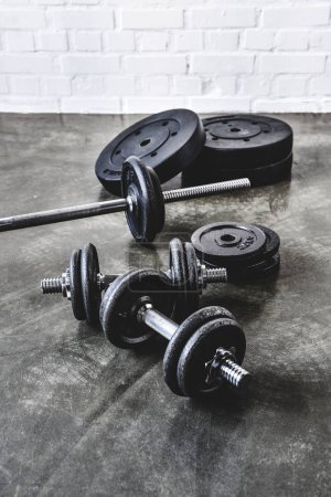 various gym equipment on concrete surface