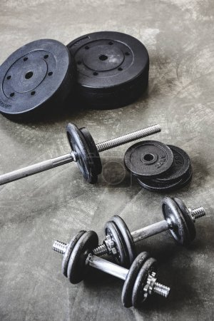 high angle view of gym equipment on concrete surface