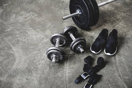 various workout equipment on concrete surface