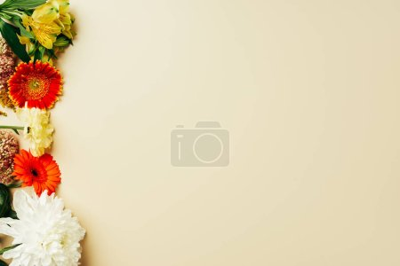flat lay with beautiful flowers arrangement on beige background