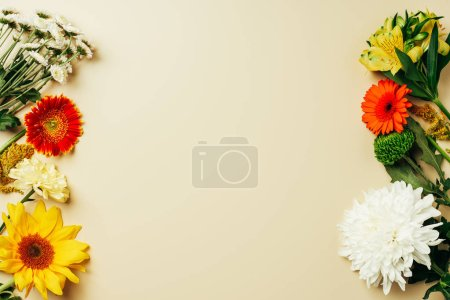 flat lay with various beautiful flowers arrangement on beige background