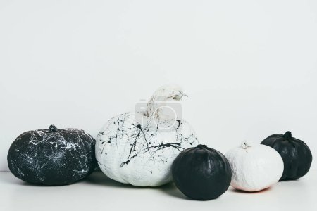scary decorative black and white pumpkins with paint splatters for traditional halloween party