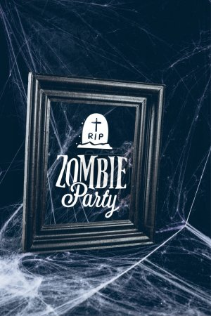 "black frame in spider web, creepy halloween decor with ""zombie party"" lettering"