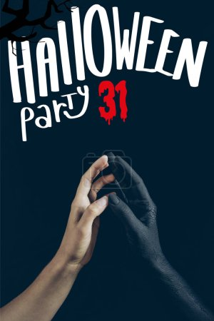 "cropped view of woman touching with black demon hand isolated on black with ""halloween party 31"" lettering"