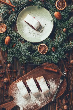 Photo for Top view of tasty baked biscuit and fir wreath on wooden table, christmas concept - Royalty Free Image