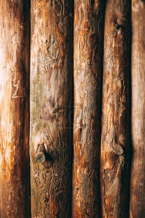 full frame of brown logs as wooden background