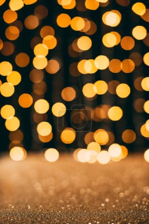golden sparkling sequins with bokeh on background, christmas concept