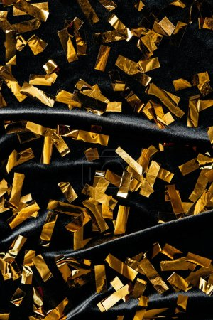 Photo for Full frame of golden confetti on black backdrop - Royalty Free Image