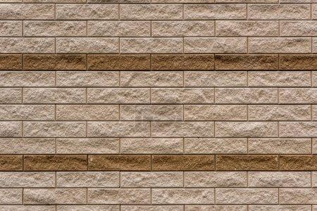 full frame image of beige stone wall background