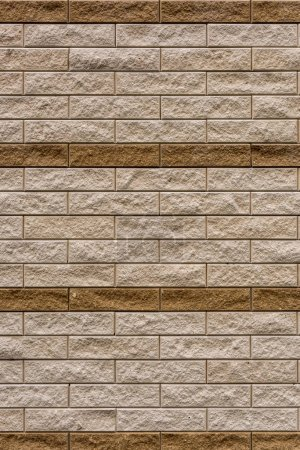 full frame image of beige stone wall background