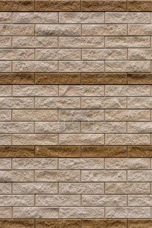 image plein cadre de fond de mur en pierre beige