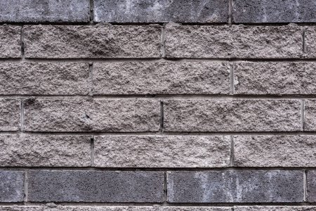 full frame image of grey stone wall background