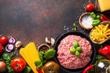 Photo for Minced meat, pasta and vegetables. Ingredients for cooking spaghetti bolognese. Top view. Food background. - Royalty Free Image