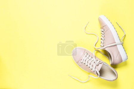 Photo for Woman fashion pink shoes on yellow background. Top view copy space. - Royalty Free Image