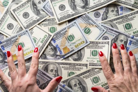 Cash money dollar and woman hands.  Conception of ...