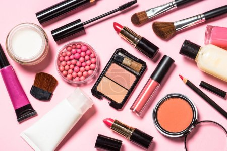 Photo for Makeup professional cosmetics on pink background. Top view with copy space. - Royalty Free Image
