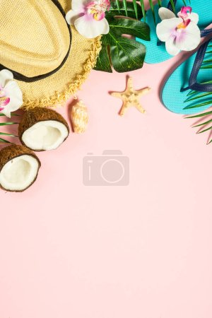 Photo for Summer holiday tropical flat lay background. Palm leaves, flip flops, sunglasses, hat and starfish on pink background. - Royalty Free Image