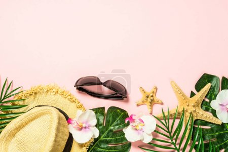Photo for Summer flat lay background. Palm leaves, flip flops, sunglasses, hat and starfish on pink background. - Royalty Free Image