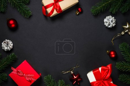 Photo for Christmas background with Present box and decorations on black background. Top view with copy space. - Royalty Free Image