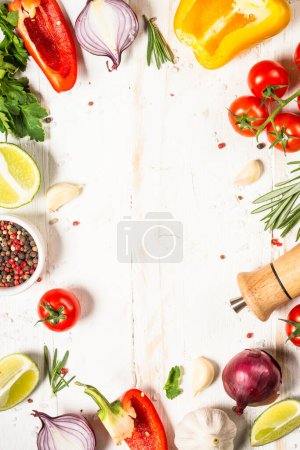 Photo for Food cooking background food frame on white wooden table. Fresh vegetables, spices, herbs and oil. Ingredients for cooking with space for your text. - Royalty Free Image