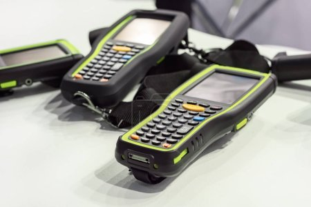 Manual laser scanners for scanning barcodes and labels.